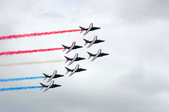 Jets formation. The Patrouille Acrobatique de France also known as the Patrouille de France or PAF, is the precision aerobatic demonstration team of the French Stock Image