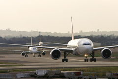 Jets lined up at a busy airport. Three jet airliners on the runway at Sydney Airport, Australia Stock Image