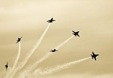 Jets Making a Smoke Knot Stock Photos
