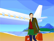Jetsetting female shopper Royalty Free Stock Images