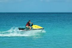 Jetski. Man on jetski taking a ride on the ocean Stock Photos
