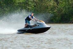 Jetski. A young man riding a jetski on the river Stock Images