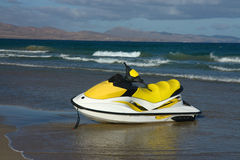 Jetski on the beach. And ocean Royalty Free Stock Photos