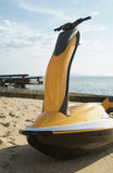Jetski on the beach. Yellow and black jetski on the beach Stock Photo