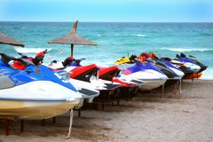 JetSki fleet. Small recreational watercraft fleet on a beach Royalty Free Stock Image