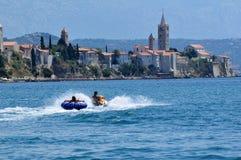 Jetski fun. Boy on yellow jetski in the Adria near the island of Rab in Croatia Stock Images
