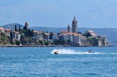 Jetski fun. Boy on yellow jetski in the Adria near the island of Rab in Croatia Royalty Free Stock Photo