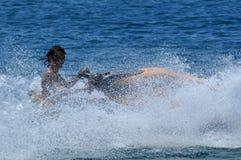 Jetski fun. Boy on yellow jetski in the Adria near the island of Rab in Croatia Royalty Free Stock Image