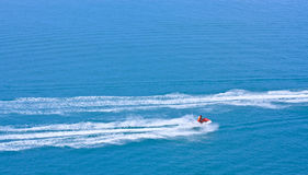 Jetski racing on blue water Royalty Free Stock Image