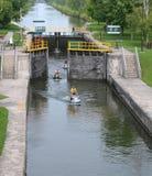 Jetskiers through a lock. Jetskiers riding through a lock Royalty Free Stock Images