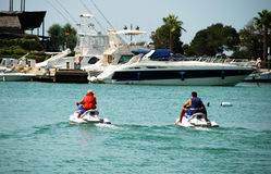 Jetskiers in Sotogrande marina. Men on jet skis in the marina, Puerto Sotogrande, Cadiz Province, Andalucia, Spain, Western Europe Stock Photography