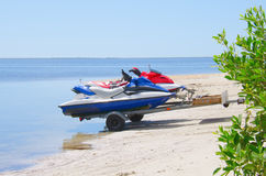 Jetskis on a trailer being launched into water Royalty Free Stock Image