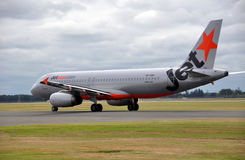 Jetstar A320 Lands at Christchurch Airport Stock Images