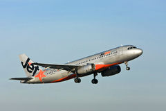 Jetstar Airbus A320 jet airliner in the air. Jetstar Airbus A320 jet Airliner in flight Stock Photography