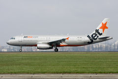 Jetstar Airbus A320 on the runway. Jetstar Airbus A330 airliner on the runway - side view Stock Images
