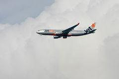 Jetstar Airbus A330 in flight. Jetstar Airbus A330 airliner flying in the clouds Royalty Free Stock Image
