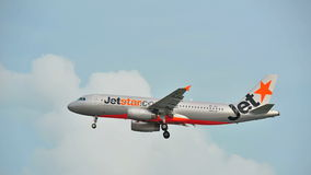 Jetstar Airbus A320 landing at Changi Airport Stock Photo