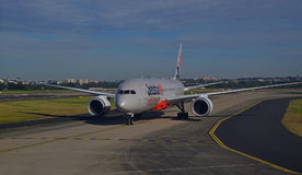 Jetstar aircraft moving on the runway with front profile at Sydney Airport Stock Photo