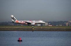 Jetstar airliner with promotional livery on tarmac Sydney airport Royalty Free Stock Photo