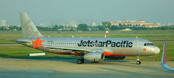 A Jetstar airplane at the Changi airport in Singapore Royalty Free Stock Photo