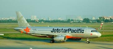 Jetstar airplane on runway at Noi Bai airport in Hanoi, Vietnam Royalty Free Stock Photo