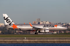 Jetstar Airways Airbus A320 airliner landing at Sydney Airport. Royalty Free Stock Photo