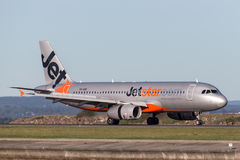 Jetstar Airways Airbus A320 airliner landing at Sydney Airport. Sydney, Australia - May 5, 2014: Jetstar Airways Airbus A320 airliner landing at Sydney Airport stock photo