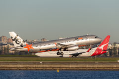 Jetstar Airways Airbus A320 airliner taking off from Sydney Airport. Royalty Free Stock Photo