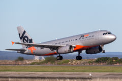 Jetstar Airways Airbus A320 airliner taking off from Sydney Airport. Royalty Free Stock Photography