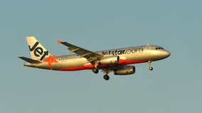 Jetstar Airways Airbus A320 landing at Changi Airport Royalty Free Stock Photography