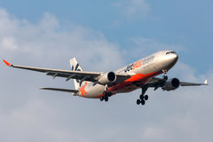 Jetstar Airways Airbus A330-203 VH-EBK on approach to land at Melbourne International Airport. Royalty Free Stock Photo