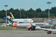 Jetstar Asia Airbus A320 and Air Zimbabwe Boeing 767 parked at Changi Airport Stock Photos