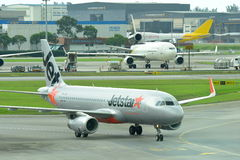 Jetstar Asia Airbus 320 low cost carrier taxiing to gate at Changi Airport Royalty Free Stock Photos