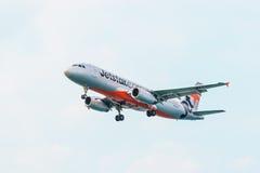 Jetstar Commercial Passenger Plane Landing in Phuket Stock Images