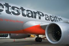 Jetstar Pacific Airbus A320. Jetstar Pacific airplane on runway at Noi Bai airport in Hanoi, Vietnam -  airport staff the plane Royalty Free Stock Image