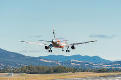 Jetstar passenger airliner coming in to land Royalty Free Stock Image