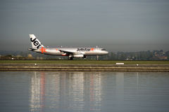 Jetstar passenger jet arrives at Kingsford-Smith airport. Sydney Royalty Free Stock Photography