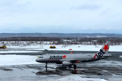 Jetstar plane getting ready for take off at Chitose airport on a snowy day Sapporo Stock Photography