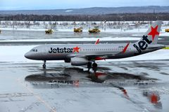 Jetstar plane getting ready to take off at Chitose airport on a snowy day Sapporo Royalty Free Stock Image