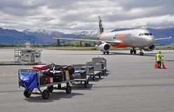 Jetstar Plane Taxies Into Queenstown Airport. Queenstown, New Zealand, 06 November 2011 Royalty Free Stock Images