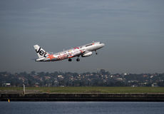 Jetstar with promotional livery departs Sydney airport Stock Photo