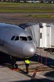 Jetstarluchtbus en gemalen bemanning royalty-vrije stock foto