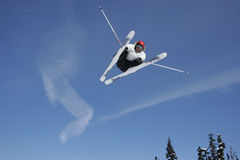 Jetstream Ski Jump. A talented skier pulls a cool trick over a huge freestyle jump Royalty Free Stock Photography