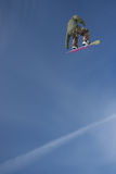 Jetstream Snowboard Air. A snowboarder launches a trick high above the halfpipe Royalty Free Stock Image