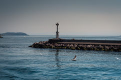 Jetties With Leading Light. On it for guiding the ships and vessels. In a bright day and blue sky Royalty Free Stock Photography