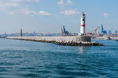 Jetties With Light House Stock Images