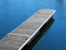Jetty 2. Landscape photo of wooden jetty at an angle in calm water royalty free stock images