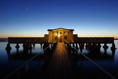 Jetty. Pier with a bath house at the end Royalty Free Stock Image