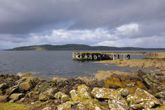 Jetty. Landscape of a jetty looking across the sea to the Isle of Arun in Scotland Stock Photo