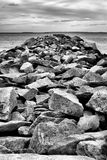 On the Jetty. Rocks of Jetty into the sea Stock Photography